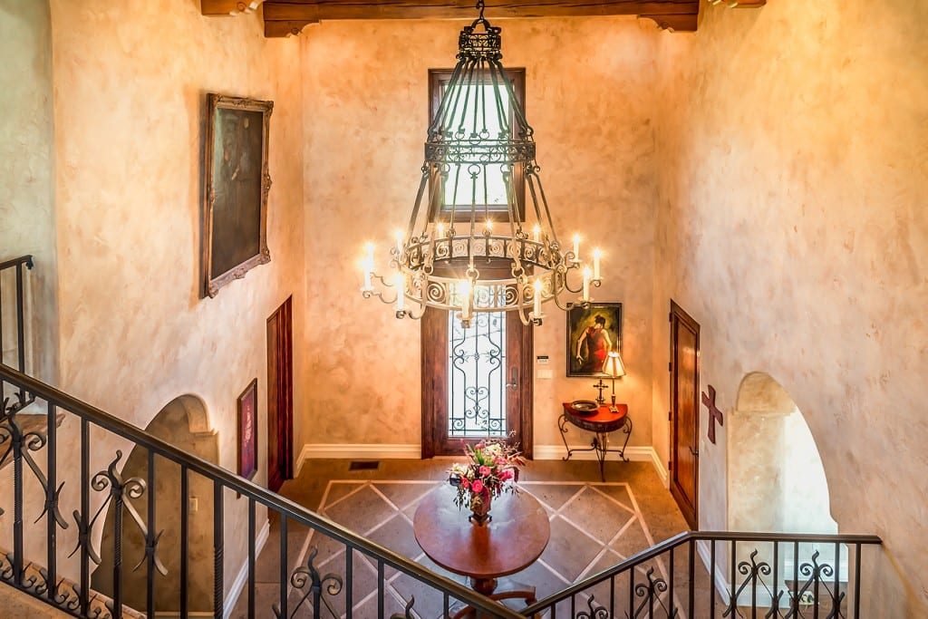 Tuscan Foyer with large iron chandelier