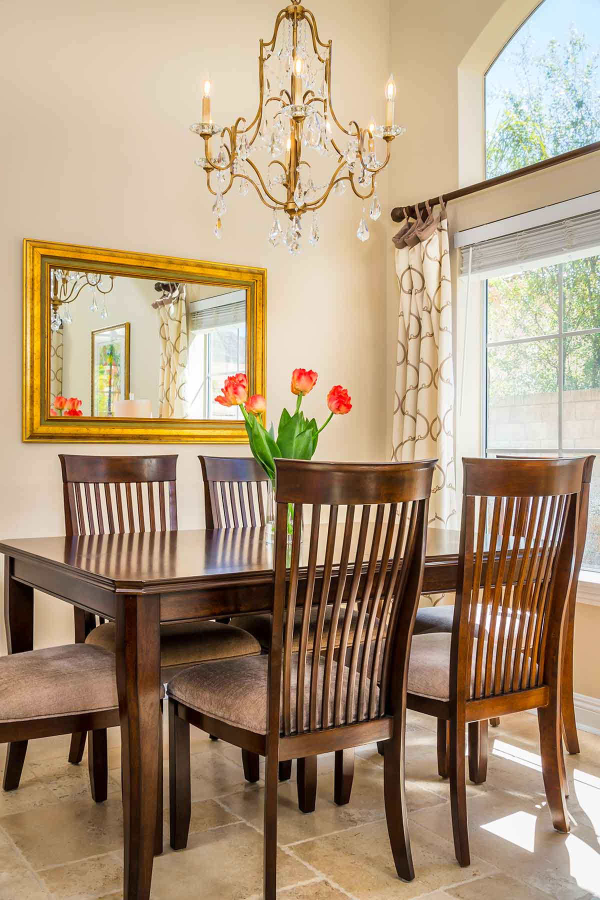 Dining Corner with chandelier and custom drapery
