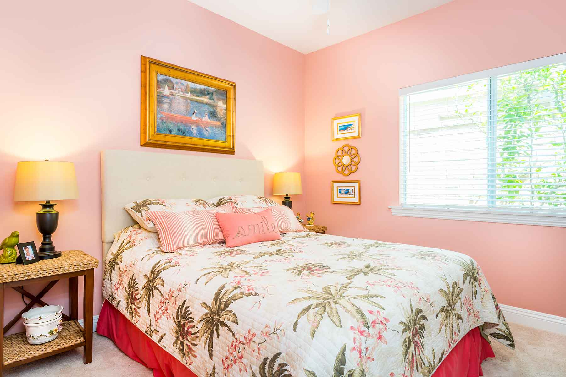 Guest room in coral and tommy bahama bedding